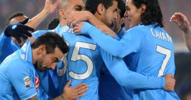 Napoli defender Miguel Ángel Britos, center, of Uruguay, is celebrated by teammates after he scored during a Serie A soccer match between Napoli and Chievo, at Naples' San Paolo stadium, Italy, Monday, Feb. 13, 2012.  Napoli won 2-0. (AP Photo/Franco Castanò)